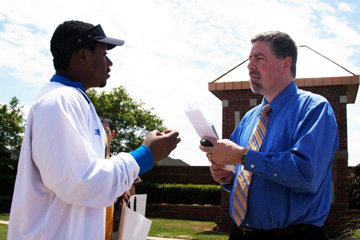 Claude Gatebuke, Rwandan activist, at Oklahoma Christian University protesting against the invitation of the Rwandan president Paul Kagame