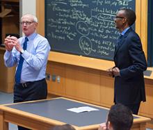 Paul Kagame and Professor Michael Porter of Harvard University - photo/Jimmy Ushkurnis